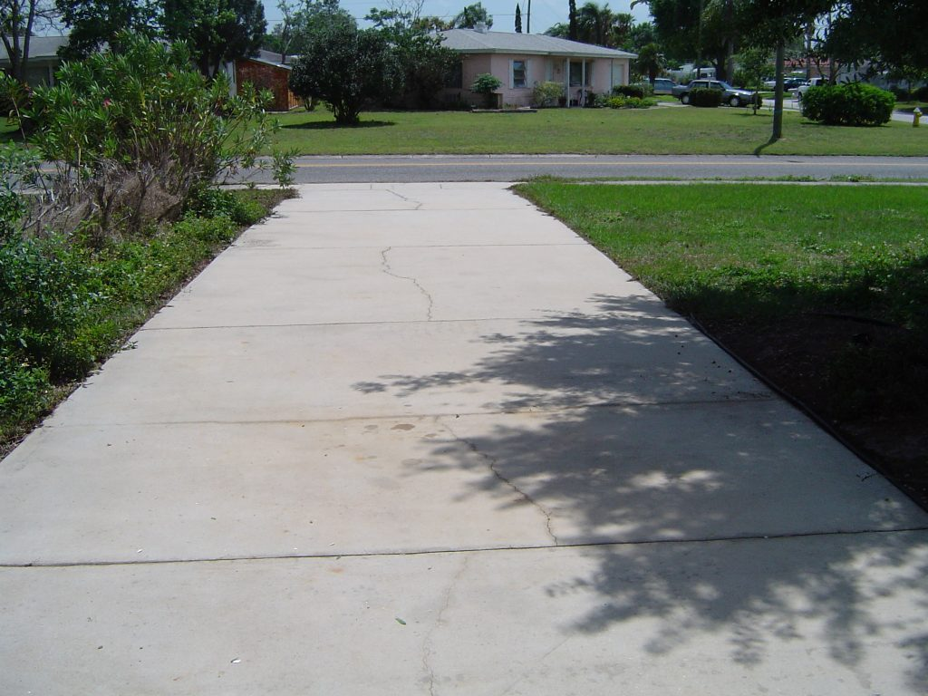 All surface pressure cleaning driveway and sidewalk for Pressure wash concrete patio